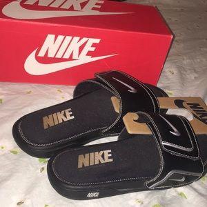 Nike slides.